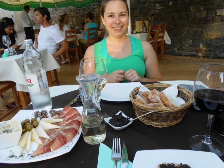 girl eating croatian feast