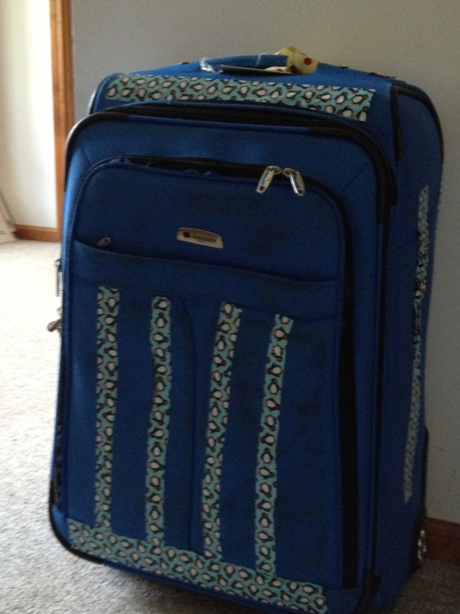 suitcase with decorative duct tape on it in a design