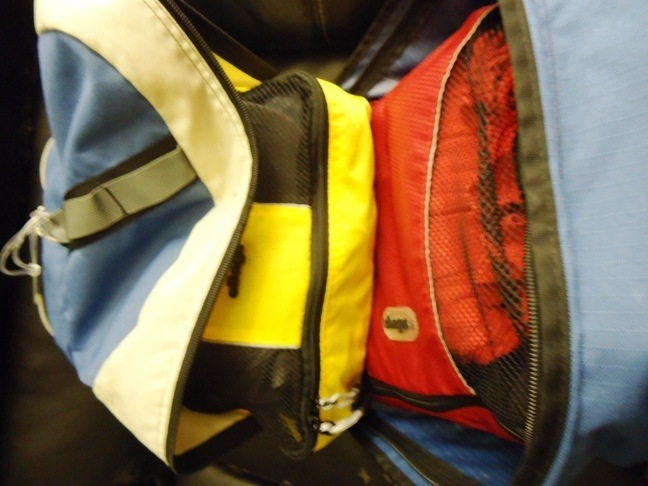 inside look at backpack filled with packing cubes to organize your suitcase