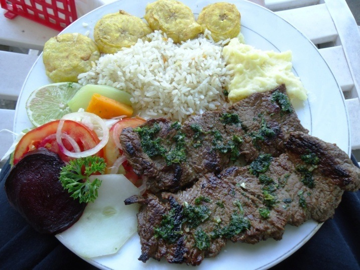 Steak with chimichurri sauce - unfortunately beef was consistently tough and overcooked