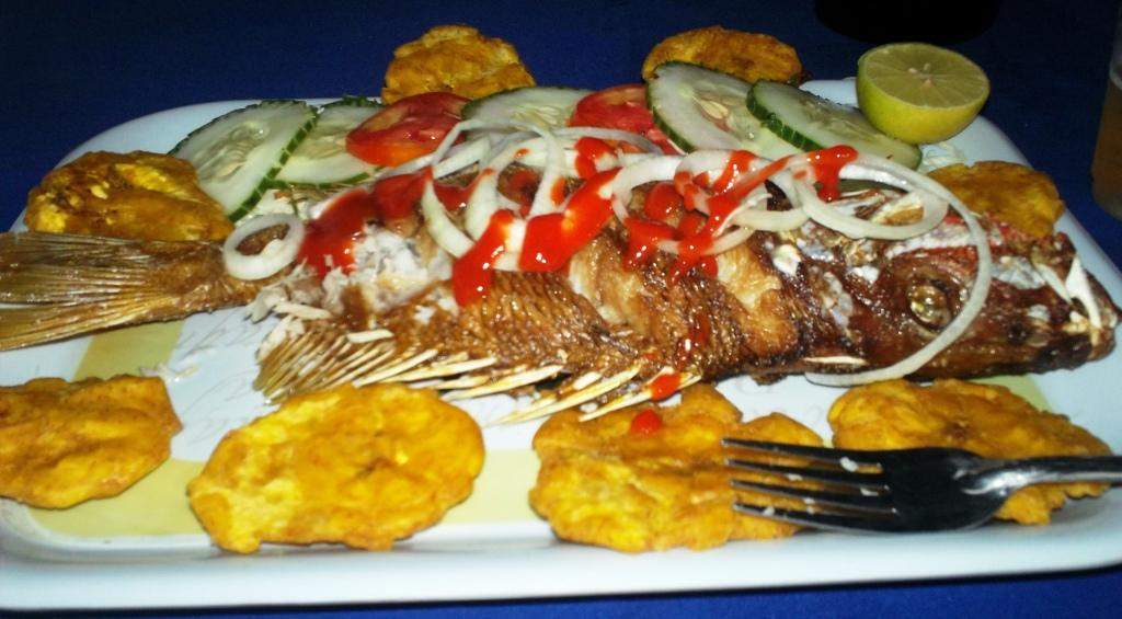 An incredibly fresh seafood dinner (red snapper, salad, and tostones)