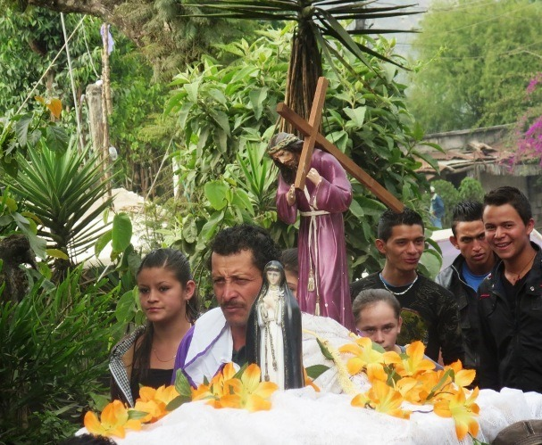A small Semana Santa Procession in the village of San Vicente Pacaya