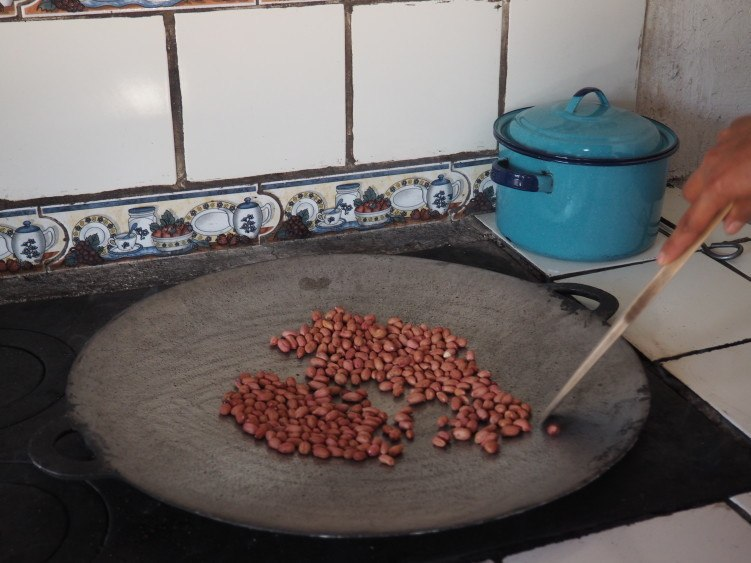 Roasting peanuts for peanut butter (de la gente workshop near antigua, guatemala)