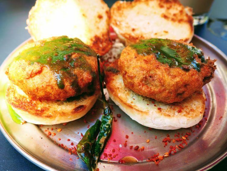 Vada Pav: spicy potato dumplings fried in curried chickpea batter and topped with green and tamarind chutneys at Chai Pani, one of the best asheville restaurants.