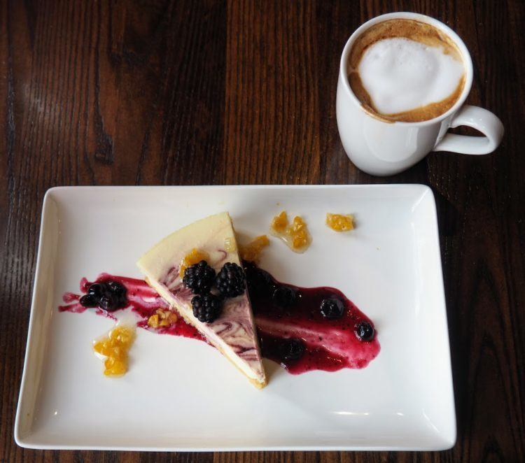A goat cheese cheesecake, with local berries and sweet corn at Red Stag Grill the best asheville restaurants