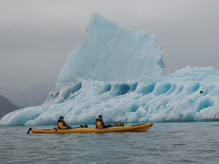 kayaking in alaska - kayak with iceberg