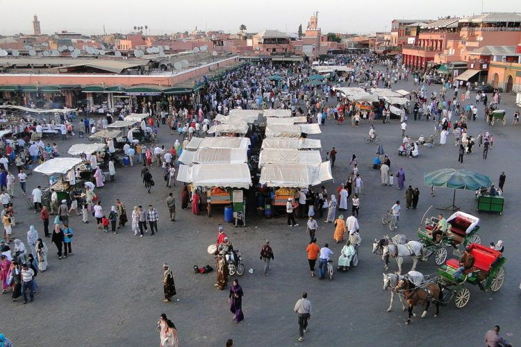 first stop on your two week morocco itinerary is the djemaa el fna square in marrakech, best in the evening