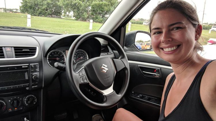 becky inside barbados rental car, with driver side on the opposite side from usa