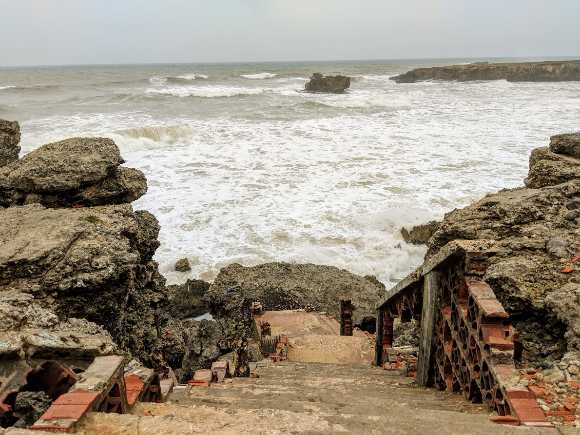 wild waves over staircase and cliffs