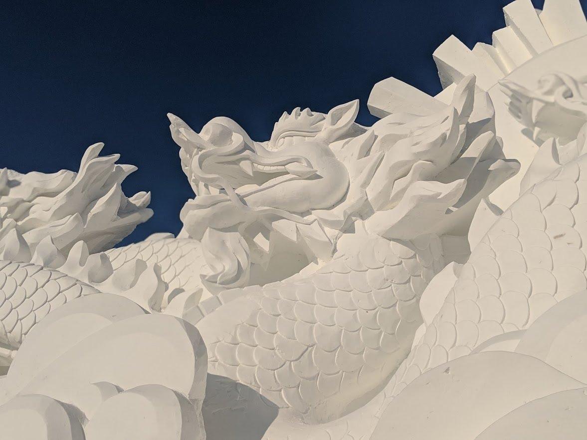 dragon snow sculpture on sun island harbin