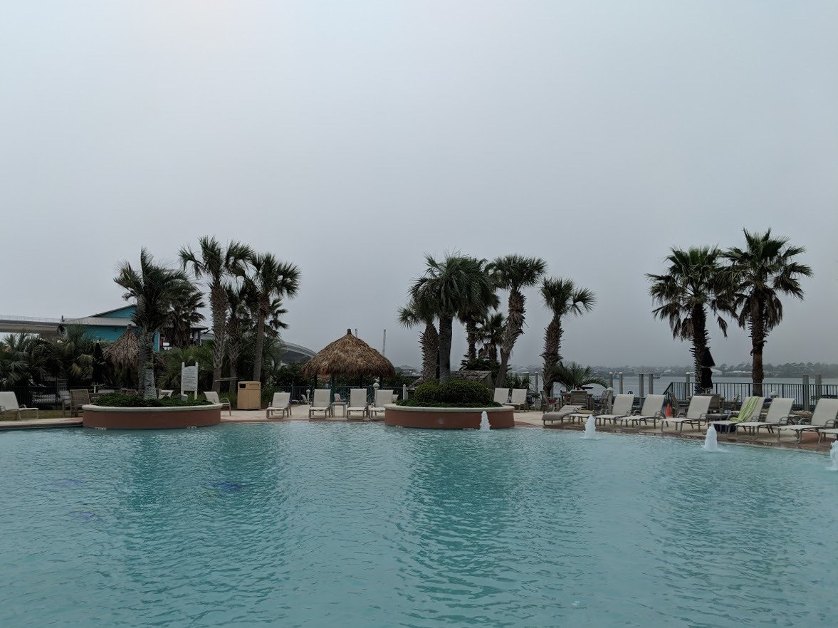 caribe resort pool on a cloudy day