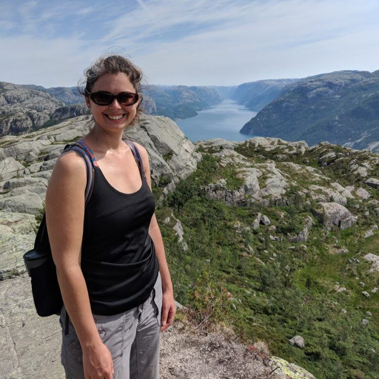 girl wearing tank top and zip off pants in norway