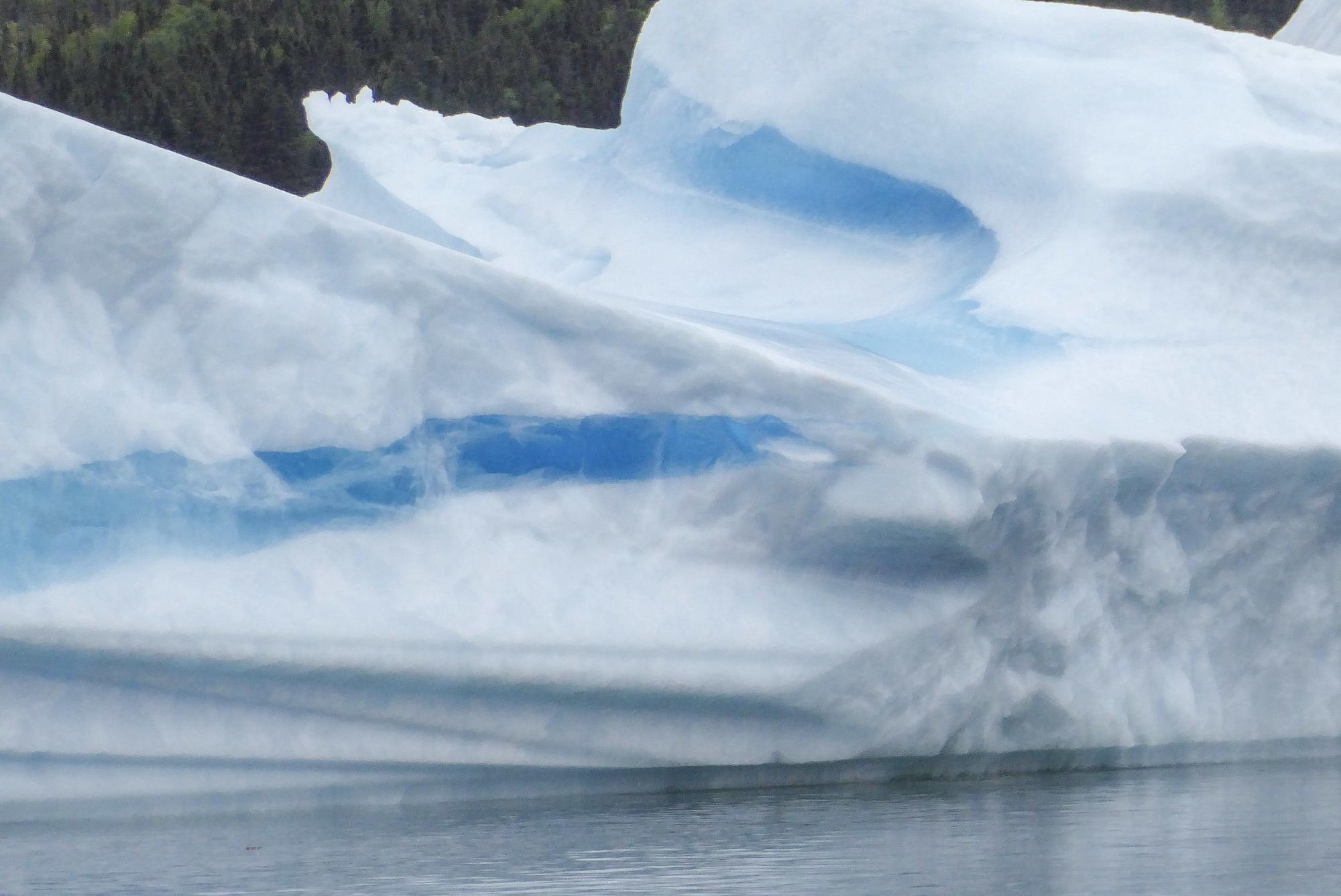 close up of blue ice on iceberg