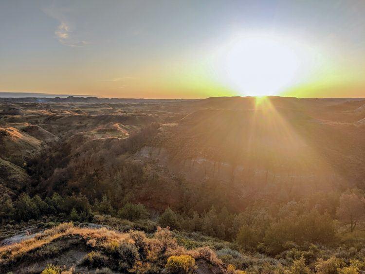 bright sunrise and sunburst in the north dakota national park