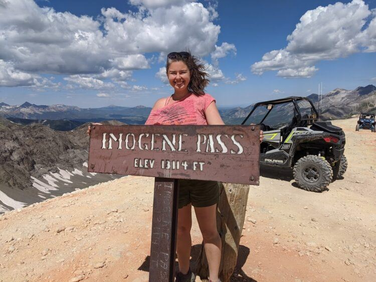 standing on top of imogene pass