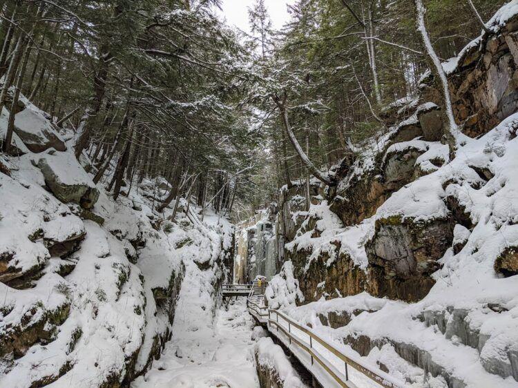 snowy boardwalks at flume gorge in winter