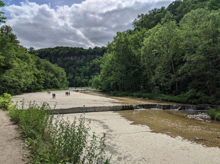 people walking along taughhanock creek near ithaca