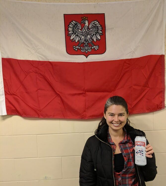 becky holding beer by polish flag
